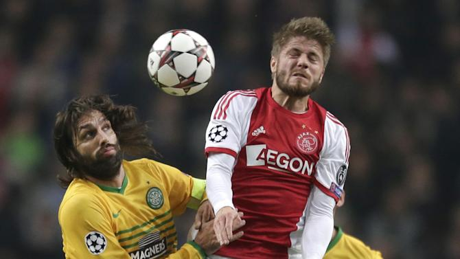 Celtic's Giorgos Samaras, left, and Ajax's Lasse Schone, right, vie for the ball during the Champions League Group H soccer match between Ajax Amsterdam and Celtic Glasgow at ArenA stadium in Amsterdam, Netherlands, Wednesday, Nov. 6, 2013