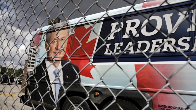The campaign bus of Canada's Prime Minister Stephen Harper leaves a tile and stone manufacturing company in Toronto