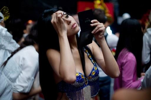 Miss World contestant, Costa Rica's Silvana Sanchez Jiminez, prepares backstage prior to a rehearsal for the final ceremony at the Ordos Stadium Arena in the inner Mongolian city of Ordos on August 17