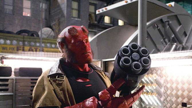 "FILE - In this image released by Universal Pictures, Ron Perlman portrays Hellboy in a scene from, ""Hellboy II: The Golden Army."" It's been two decades since Mike Mignola created a horned, red-hued devilish beast with a penchant for cigars and a really big gun. In that time, Hellboy has jumped from the pages of Dark Horse Comics to animation and film and the writer and artist plans to keep his character moving ever onward. (AP Photo/Universal Pictures, Egon Endrenyi)"
