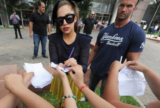 "Lady Gaga signs autographs for fans in Paraguay, on November 26, 2012. She has canceled the rest of her ""Born This Way Ball"" tour due to a long-standing hip problem that requires surgery"