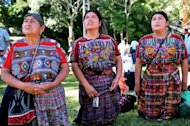 Guatemalan Maya natives kneel in front of a temple at the Tikal archaeological site on December 20, 2012. The exquisite site of Mayan ruins began hosting winter solstice ceremonies on Thursday as the region's indigenous people marked the end of an era