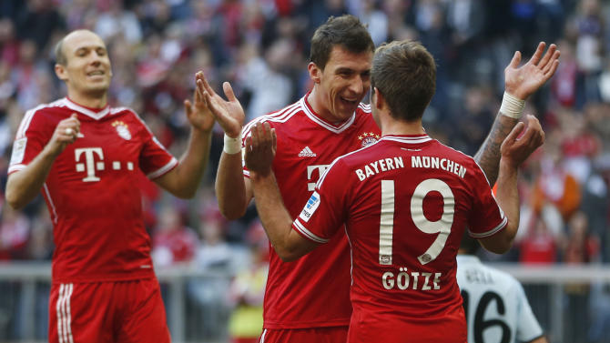 Bayern's Mario Mandzukic of Croatia, center, celebrates with team mate Mario Goetze after scoring his side's third goal during the German first division Bundesliga soccer match between FC Bayern Munich and FSV Mainz 05, in Munich, southern Germany, Saturday, Oct. 19, 2013
