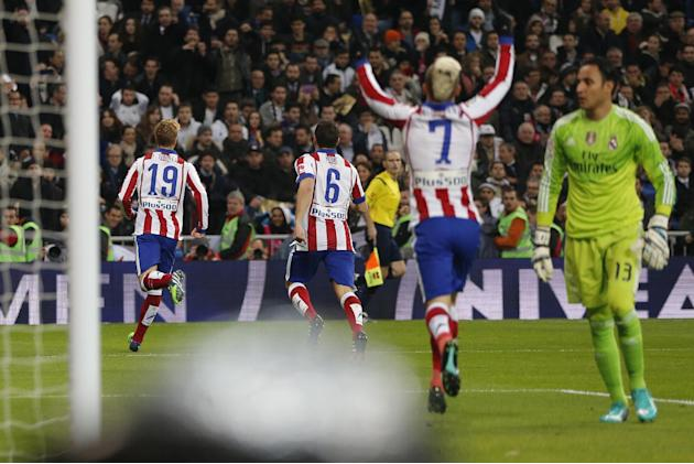 Atletico de Madrid Fernando Torres celebrates after scoring a goal during a King's Cup soccer match between Atletico de Madrid and Real Madrid at the Santiago Bernabeu stadium in Madrid, Spain, Thursd