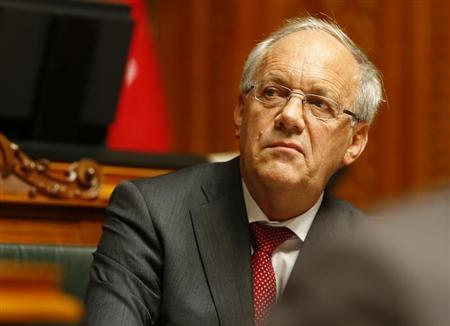 Swiss Economy Minister Johann Schneider-Ammann follows the debate of the 'Minimal Salary' initiative in the National Council in Bern November 27, 2013 file photo. REUTERS/Ruben Sprich