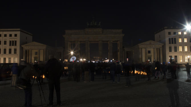 The Brandenburger Gate is seen in darkness during Earth Hour in Berlin, Saturday, March 23, 2013. Earth Hour was marked worldwide at 8.30 p.m. local time and is a global call to turn off lights for 60 minutes in a bid to highlight the global climate change.(AP Photo/Markus Schreiber)