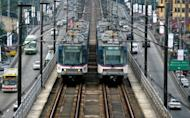 Two Metro Rail Transit trains pass each other in Manila in 2010. Australia's Macquarie Group and the Asian Development Bank said Tuesday they were teaming up with other investors to open a $625 million private equity fund focused on vital infrastructure in the Philippines