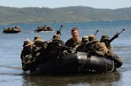 US and Filipino soldiers are seen on a boat during a joint mock beachfront assault on the shore of Ulugan Bay on Palawan island in April 2012. The Philippines says it has secured a pledge from its key military ally, the United States, that it would protect it from attacks in the South China Sea