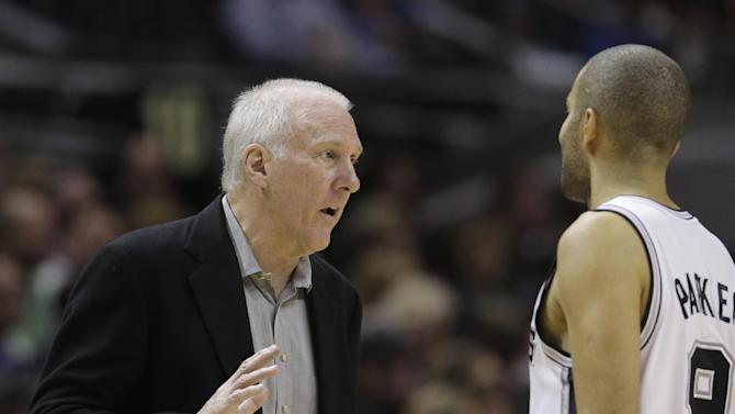 San Antonio Spurs coach Gregg Popovich, left, talks with Tony Parker during the second half on an NBA basketball game against New York Knicks, Thursday, Jan. 2, 2014, in San Antonio. New York won 105-101