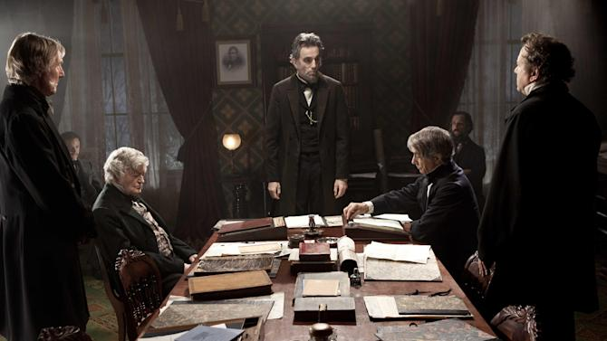"""This undated publicity photo released by Walt Disney Pictures shows, Daniel Day-Lewis, center rear, as Abraham Lincoln, in a scene from the film, """"Lincoln."""" """"Lincoln"""" opens in limited release Nov. 9, 2012, and nationwide Nov. 16, just after the U.S. presidential election. (AP Photo/Disney-DreamWorks II, David James)"""