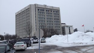 A 2014 consultant's report found the CRA building at 875 Heron Rd. would need to remove asbestos containing materials and debris in order to comply with federal regulations. (Julie Ireton/CBC)