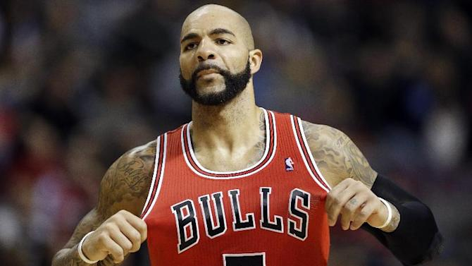 Chicago Bulls forward Carlos Boozer enters the game during the second quarter of an NBA basketball game against the Detroit Pistons in Auburn Hills, Mich., Wednesday, Nov. 27, 2013