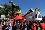 People take part in a demonstration in Madrid on September 15. Mass protests in Spain and Portugal, against ever tougher austerity measures, have ramped up the pressure on Iberian governments struggling to avoid international bailouts