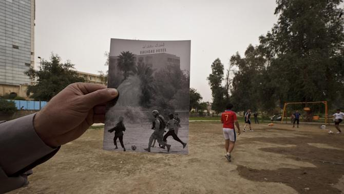 This Tuesday, March 12, 2013 photo shows a general view of Abu Nawas park in Baghdad, at the site of a photograph taken by Maya Alleruzzo showing Iraqi orphans playing soccer with a U.S. soldier from the Third Infantry Division in April, 2003. The park that runs along Abu Nawas Street, named after an Arabic poet, is now a popular destination for families who are drawn by the manicured gardens, playgrounds and restaurants famous for a fish called mazgouf. Ten years ago, the park was home to a tribe of children orphaned by the war and was rife with crime. (AP Photo/Maya Alleruzzo)