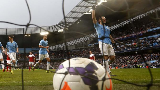 Manchester City's Demachelis celebrates after scoring a goal during their English Premier League soccer match against Fulham at the Etihad stadium in Manchester