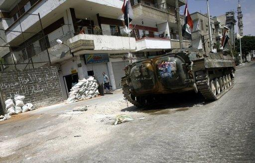 A Syrian military tank patrols the restive city of Homs. Syrian government forces have used sexual violence to torture men, women, girls and boys detained during the current conflict, according to Human Rights Watch