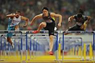 Liu Xiang of China (C) wins the men's 110m hurdle event with Jason Richardson (R) and Aries Merritt (both of the US) trailing during their Diamond League athletics meet in Shanghai, on May 19. Liu clocked 12.97sec in wet conditions, a season's best