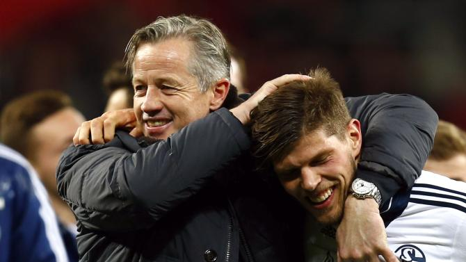 Schalke 04's Huntelaar and coach Keller celebrate after they won their German first division Bundesliga soccer match against Bayer Leverkusen in Leverkusen