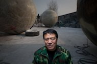 "This photo taken on December 11, 2012 shows farmer Liu Qiyuan with the survival pods that he created and dubbed ""Noah's Arc"", in the village of Qiantun, south of Beijing. As people across the globe tremble in anticipation of next week's supposed Mayan-predicted apocalypse, Liu says he may have just what humanity needs"
