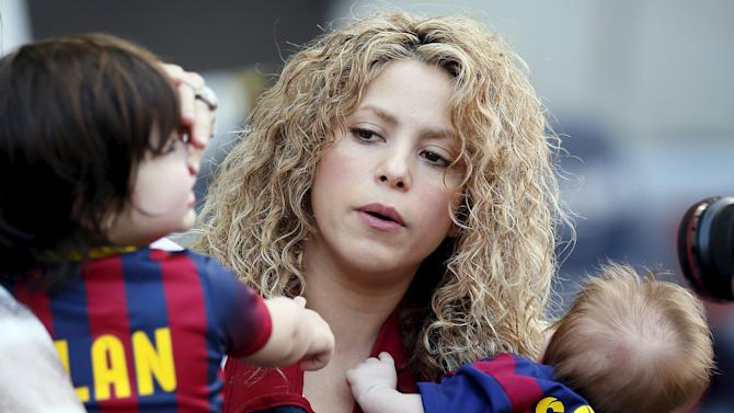 Singer Shakira holds her sons Sasha and Milan before the Spanish first division soccer match between Barcelona and Valencia at Camp Nou stadium in Barcelona