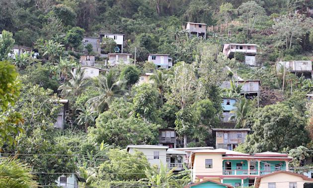 Cricket: Local houses on the hillside surround the ground