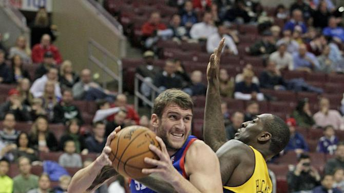 Denver Nuggets'  JJ Hickson (7) defends as Philadelphia 76ers' Spencer Hawes (00) looks to pass in the first half of an NBA basketball game Saturday Dec. 7, 2013, in Philadelphia. The Nuggets won 103-92