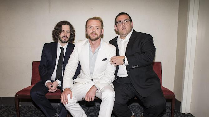 """In this Wed., Aug. 21, 2013 photo, from left, director Edgar Wright, actor Simon Pegg, and actor Nick Frost pose for a portrait in the green room at the premiere of the feature film """"The World's End"""" at the Cinerama Dome, in Los Angeles. It's not the end of the world, but """"The World's End"""" marks a creative conclusion for Pegg, Frost and Wright. For the British trio behind """"Shaun of the Dead"""" and """"Hot Fuzz,"""" the release on Friday, Aug. 23, 2013 of """"The World's End"""" completes a trilogy. (Photo by Dan Steinberg/Invision/AP)"""