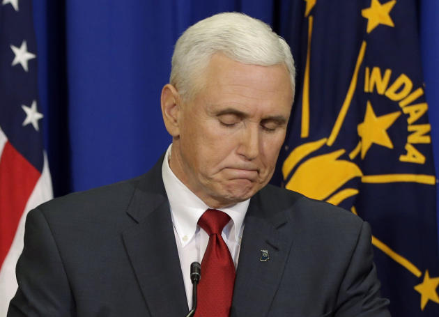 Indiana Gov. Mike Pence listens to a question during a news conference, Tuesday, March 31, 2015, in Indianapolis. Pence said that he wants legislation on his desk by the end of the week to clarify tha
