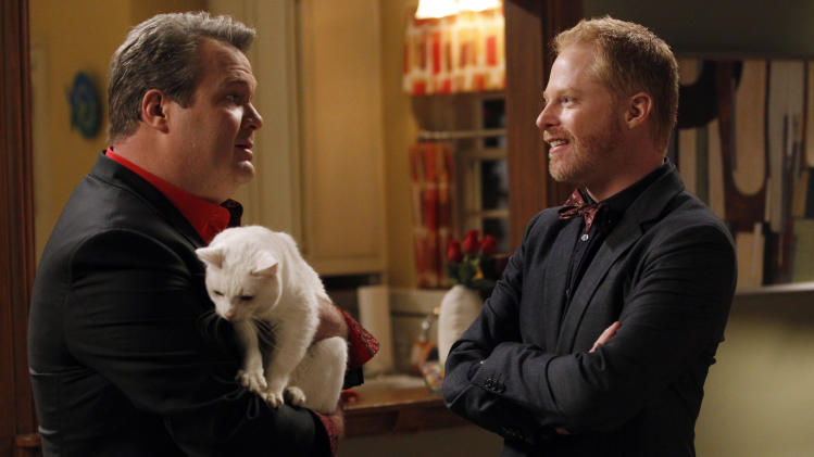 "This image released by ABC shows Eric Stonestreet, left, and Jesse Tyler Ferguson in a scne from ""Modern Family."" (AP Photo/ABC, Peter ""Hopper"" Stone)"