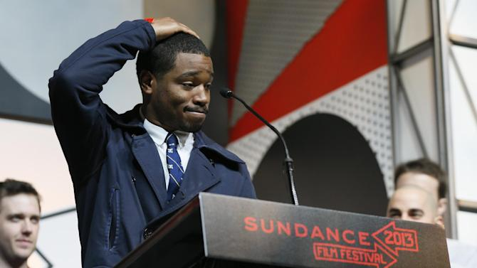 """FILE - In this Jan. 26, 2013 file photo director-screenwriter Ryan Coogler accepts the U.S. Grand Jury Prize: Dramatic for his film, """"Fruitvale"""" during the 2013 Sundance Film Festival Awards Ceremony in Park City, Utah. Coogler's """"Fruitvale Station"""" _ his first dramatic feature and first project since graduating with a master's degree in 2011 _ won both jury and audience awards at the Sundance Film Festival. Originally called """"Fruitvale,"""" the film opens Friday, July 12, in New York and Los Angeles and around the nation later this month, and Oscar buzz has already begun. (Photo by Danny Moloshok/Invision/AP, file)"""