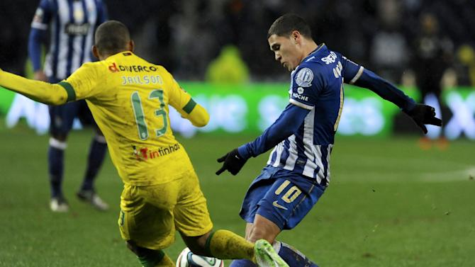 FC Porto's Juan Quintero, from Colombia, challenges Pacos Ferreira's Jailson Araujo, from Brazil, in a Portuguese League soccer match at the Dragao stadium in Porto, Portugal, Sunday, Feb. 9, 2014. Porto won 3-0