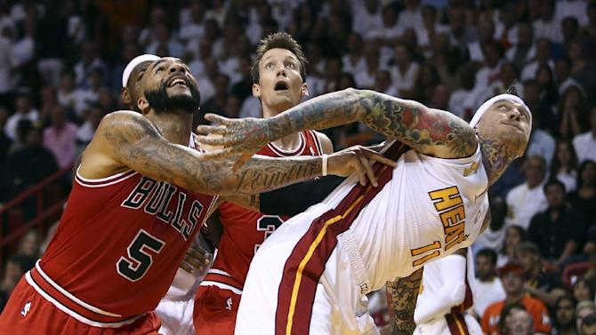 Chicago Bulls Carlos Boozer (5) and Mike Dunleavy battle for a rebound with the Miami Heat's Chris Andersen (11) during the first half of an NBA basketball game in Miami, Tuesday, Oct. 29, 2013