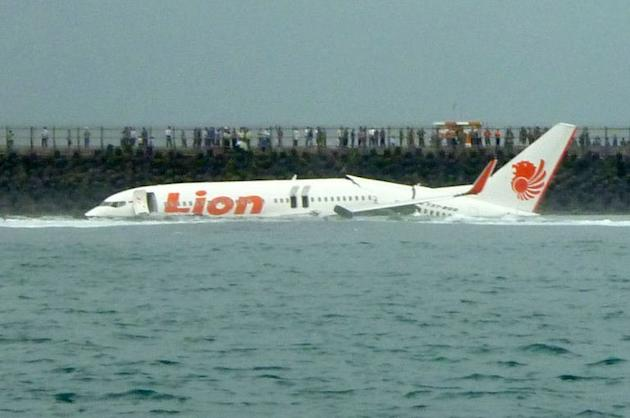 A Lion Air Boeing 737 lies submerged in the water after skidding off the runaway, April 13, 2013