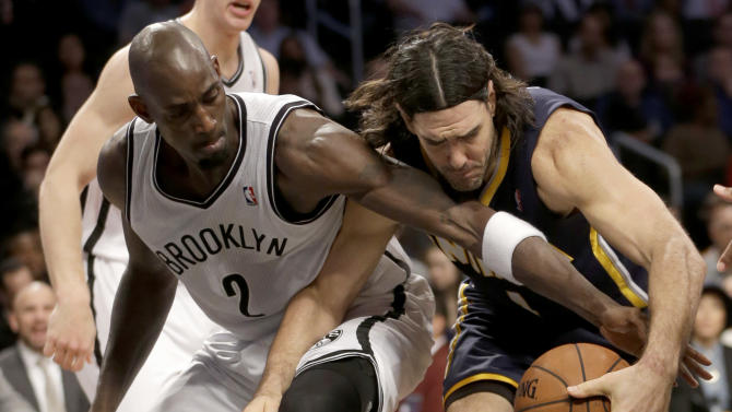 Brooklyn Nets' Kevin Garnett, left, competes for a rebound with Indiana Pacers' Luis Scola during the first half of an NBA basketball game Monday, Dec. 23, 2013 in New York