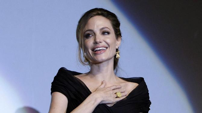 "FILE - This Feb. 14, 2012 file photo shows US actress and director Angelina Jolie addressing the audience after premiere of her movie, ""In the Land of Blood and Honey,"" in  Sarajevo,  Bosnia. Jolie says that she has had a preventive double mastectomy after learning she carried a gene that made it extremely likely she would get breast cancer. The Oscar-winning actress and partner to Brad Pitt made the announcement in  an op-ed she authored for Tuesday's New York Times under the headline, ""My Medical Choice."" She writes that between early February and late April she completed three months of surgical procedures to remove both breasts. (AP Photo/Amel Emric, file)"