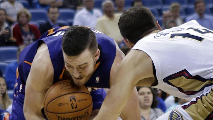 Phoenix Suns power forward Miles Plumlee battles for a loose ball with New Orleans Pelicans power forward Jason Smith (14) in the first half of an NBA basketball game in New Orleans, Tuesday, Nov. 5, 2013