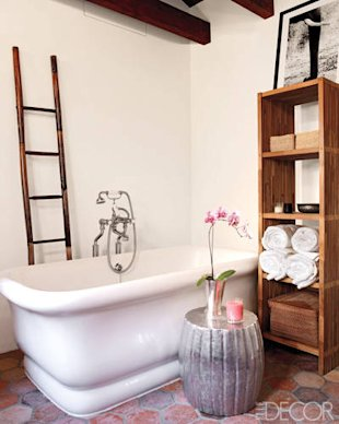 This master bathroom exudes rustic elegance. An antique bamboo ladder adds vertical interest, while a zinc garden stool adds glamour. Click the photo ...