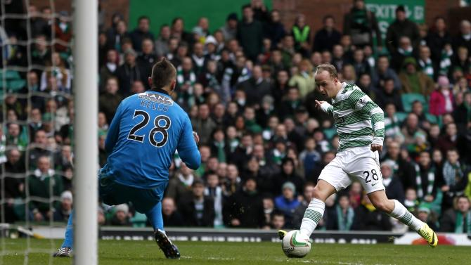 Celtic's Leigh Griffiths puts the ball past St Mirren goalkeeper Marian Kello to score during their Scottish Premier League soccer match at Celtic Park Stadium in Glasgow