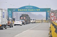 Vehicles line up at a South Korean military check point on the road to the Kaesong Industrial complex across the border in North Korea, April 1, 2013. North Korea has delayed the entry of South Koreans to Kaesong in a rare move amid high tensions on the Korean peninsula, the South's Unification Ministry said.