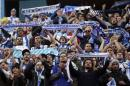 Deportivo Coruna's supporters react during their Spanish first division soccer match against Atletico Madrid in Madrid