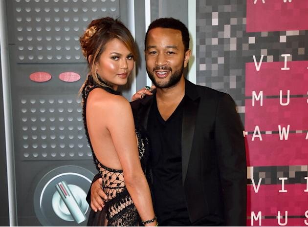 FILE - In this Aug. 30, 2015 file photo, Chrissy Teigen, left, and John Legend arrive at the MTV Video Music Awards in Los Angeles. Teigen and Legend announced on their Instagram accounts, Monday, Oct