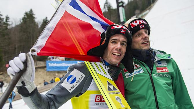 Norway's Anders Bardal (L) poses with Alexander Stoeckl, head coach of Norwegian Ski jumping Team, after winning the overall FIS Ski Jumping World Cup 2011-2012 in Planica on March 18, 2012.  AFP PHOTO / Jure Makovec (Photo credit should read Jure Makovec/AFP/Getty Images)