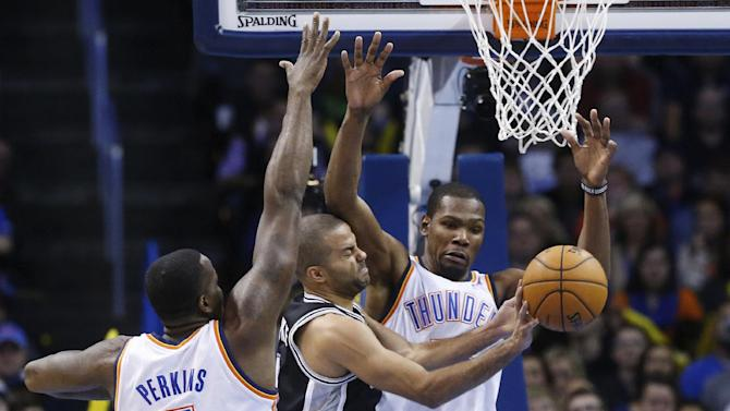 San Antonio Spurs guard Tony Parker (9) passes off between Oklahoma City Thunder center Kendrick Perkins (5) and forward Kevin Durant (35) in the second quarter of an NBA basketball game in Oklahoma City, Wednesday, Nov. 27, 2013