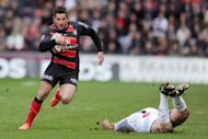 Toulouse's centre Florian Fritz runs with the ball during their French Top 14 rugby union match against Brive at the Ernest Wallon stadium in Toulouse, southwestern France