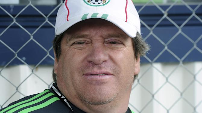 Mexico's soccer coach Miguel Herrera watches his players train for their upcoming World Cup qualifying match against New Zealand, at Dave Farrington Park, in Wellington, New Zealand, Sunday, Nov. 17, 2013