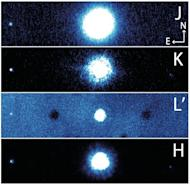 The planetary system around the star HAT-P-7 includes a companion star and two planets. These photos of the system were taken by the Subaru Telescope.