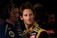 "Lotus driver Romain Grosjean, seen here in August 2012, admitted that he made ""a stupid mistake"" in Japan, where Mark Webber branded him ""a first-lap nutcase"", but said that it was time to move on"