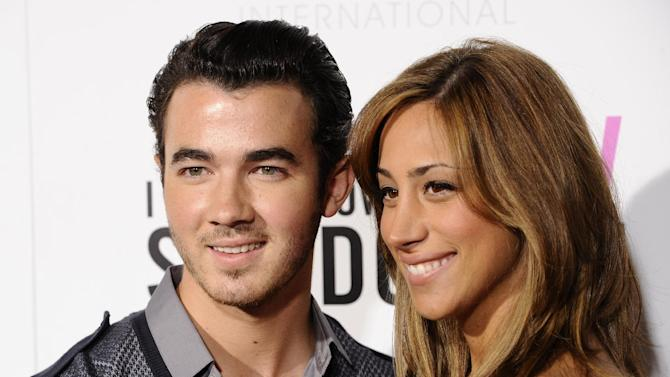 "FILE - In this Sept. 12, 2011 file photo, singer Kevin Jonas and his wife Danielle Deleasa attend the Cinema Society premiere of ""I Don't Know How She Does It"", in New York.  The E! Entertainment network has expansion plans that include a new music series from ""American Idol"" producer Nigel Lythgoe, a reality series with Kevin Jonas, the oldest member of the Jonas Brothers and his new bride and a talk show starring Whitney Cummings. (AP Photo/Peter Kramer, file)"