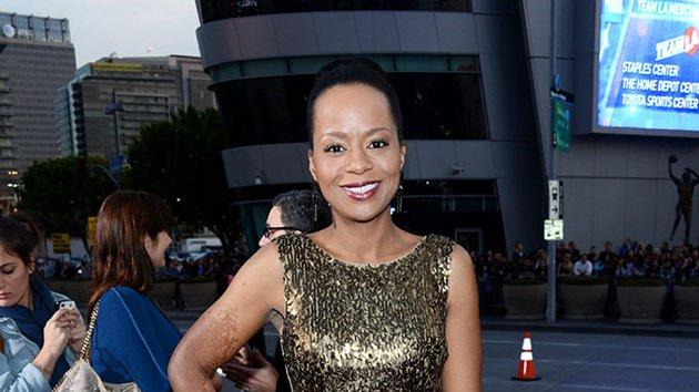 """BEST: Tempestt Bledsoe.  Bledsoe is all that glitters in a form-fitting gold dress. The """"Guys With Kids"""" star kept her ensemble balanced with a simple, slicked-back updo and black heels."""