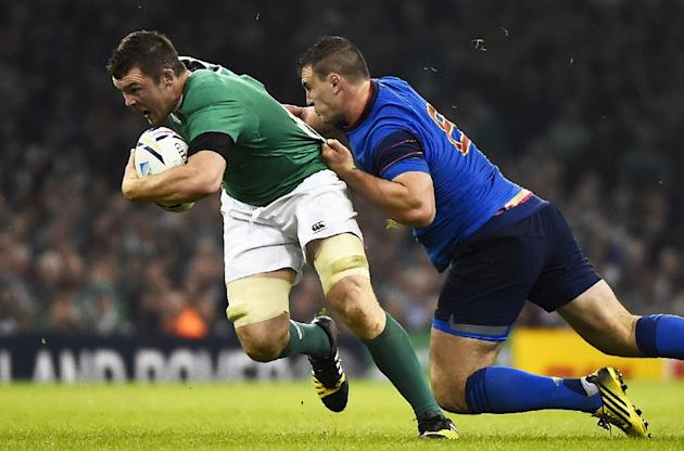 Ireland's Peter O'Mahony (left) is tackled by France's Louis Picamoles during the Rugby World Cup match at the Millennium Stadium in Cardiff, on October 11, 2015